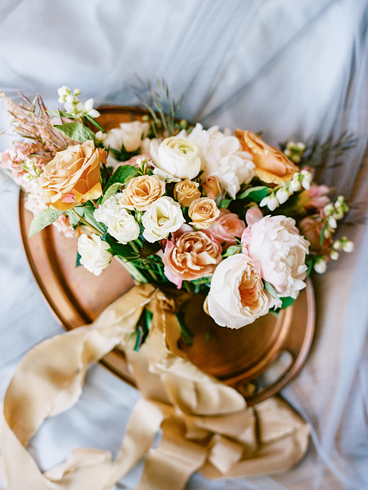 gold, pink, and cream bouquet by Sarah's Garden, tied with silk ribbon