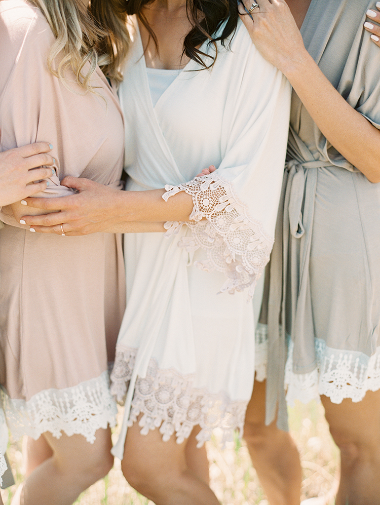 bridesmaids and bride in Plum Pretty Sugar robes