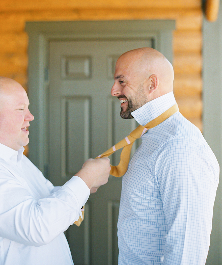 helping the groom with his tie