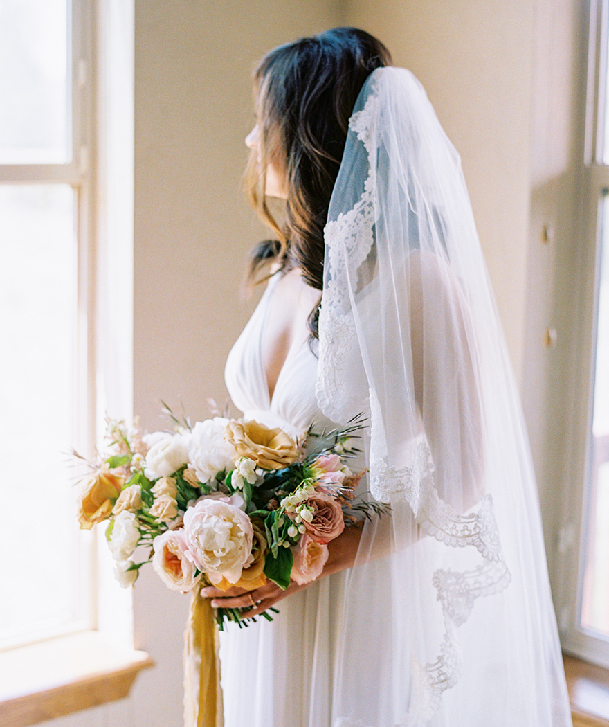 gold, pink, and cream bouquet by Sarah's Garden, veil with scalloped lace