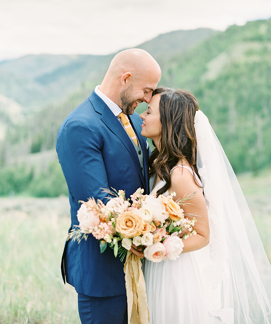 loving bride & groom in the Colorado mountains