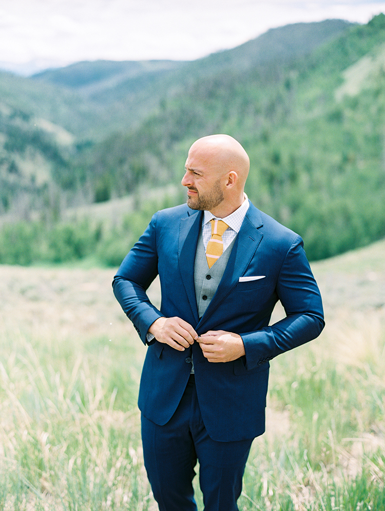 custom three-piece suit for a dapper groom