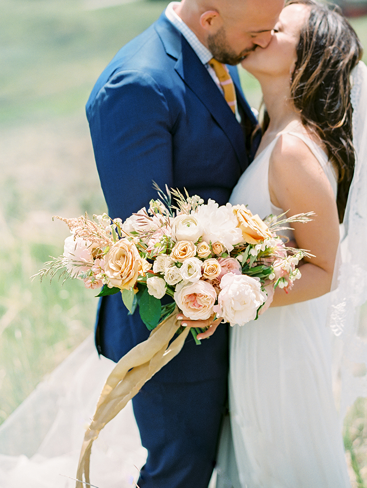 bridal bouquet in gold, pink, and cream by Sarah's Garden