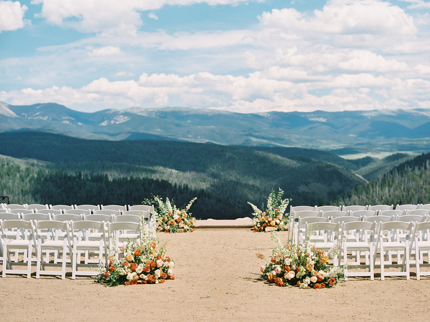 mountaintop Colorado wedding with flowers in gold, pink, and cream