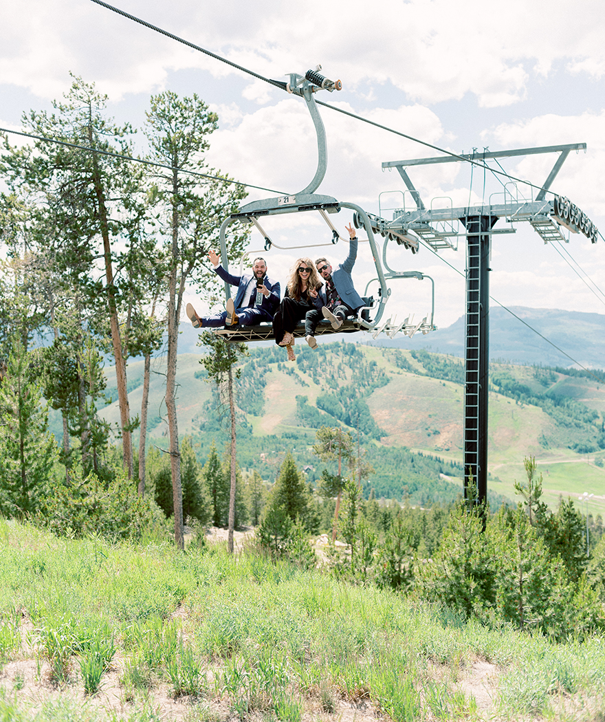 taking the ski lift to a mountaintop wedding