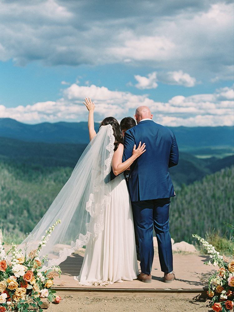 feeling the presence of the Spirit - mountaintop Colorado wedding