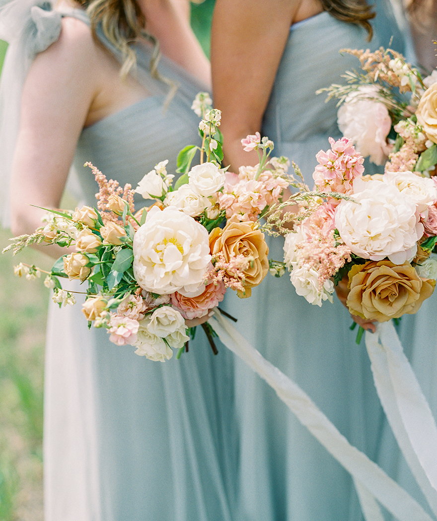 bridesmaid bouquets in gold, pink, and cream by Sarah's Garden