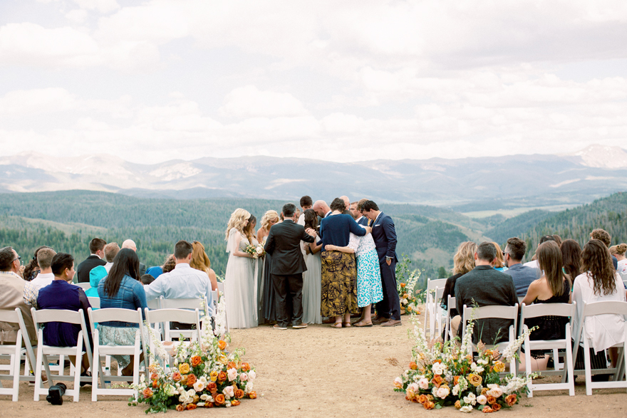 praying with the bride & groom