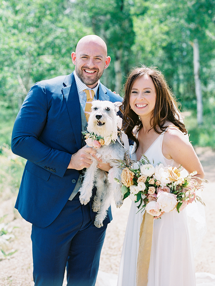 happy bride & groom with their miniature schnauzer