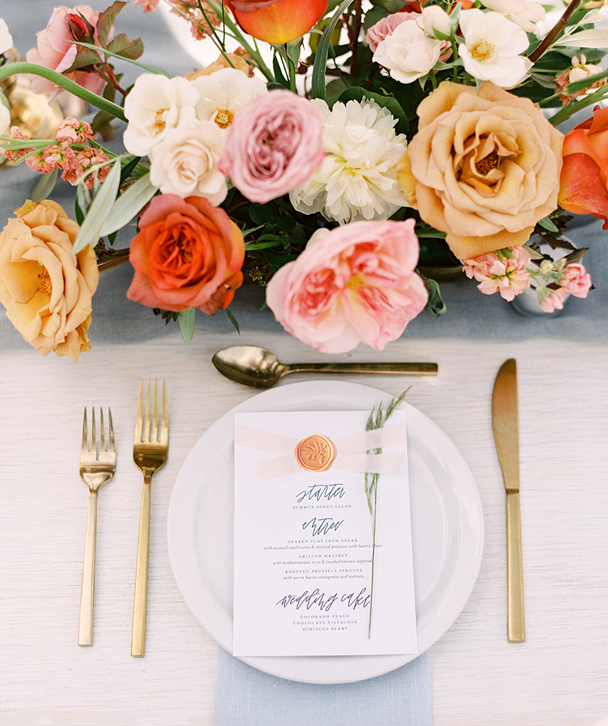 hand-lettered menu and richly colored wedding flowers