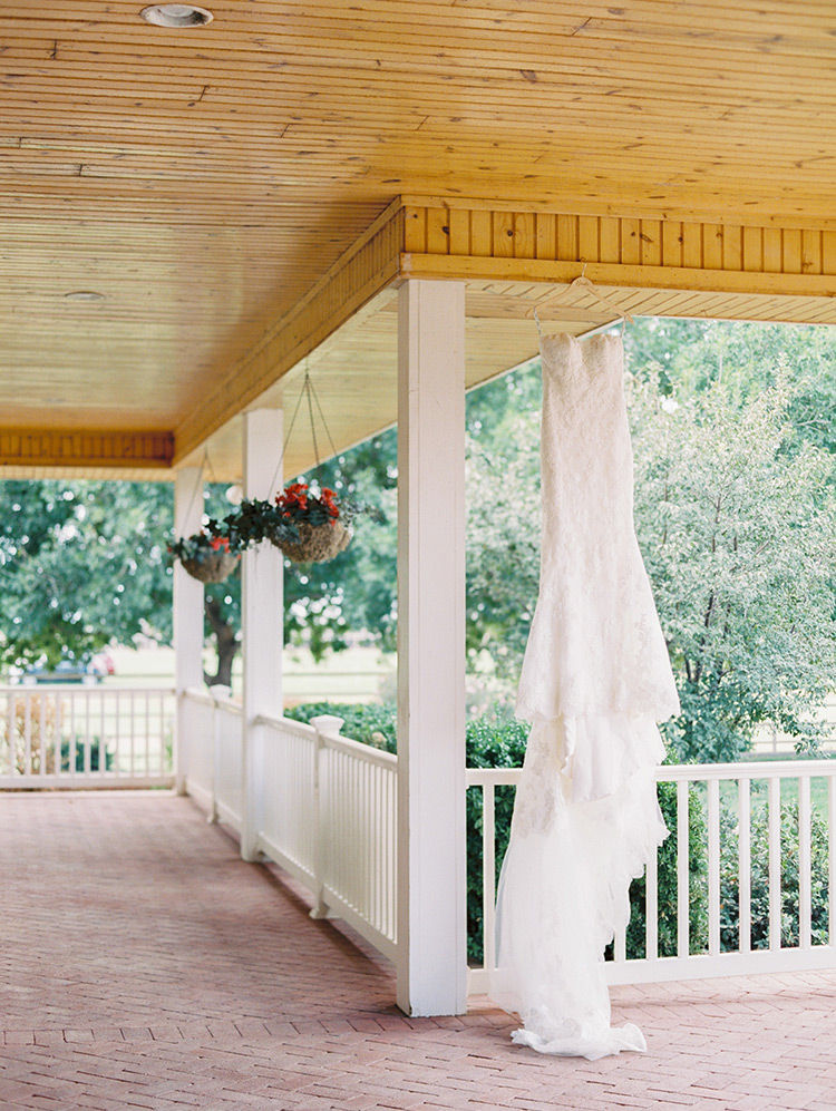 wedding dress on the porch of a modern farmhouse
