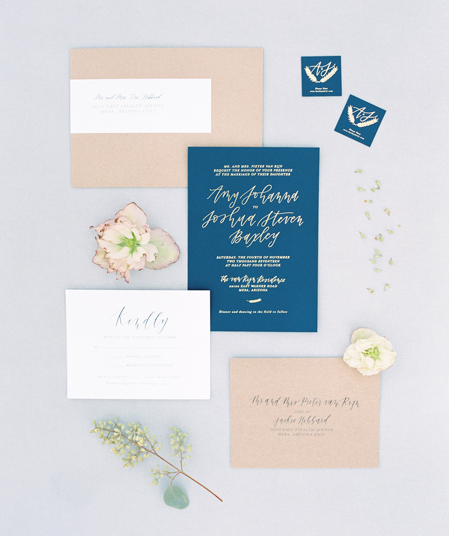 wedding invitation suite in blue and blush