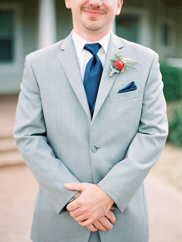 groomsman in blue and gray