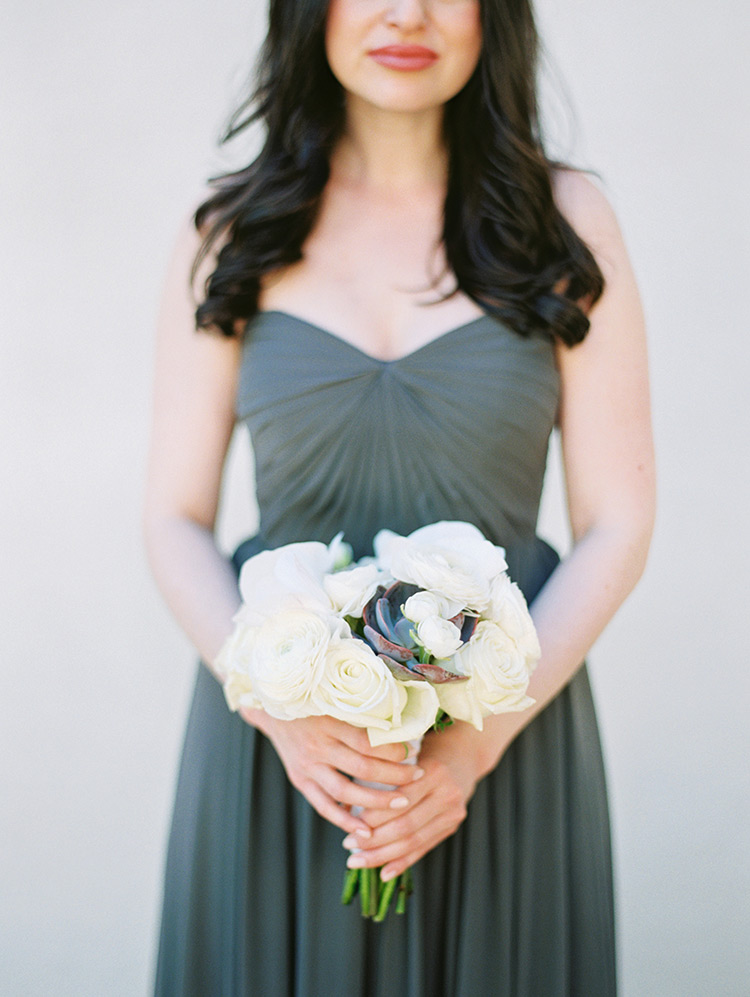 bridesmaid bouquet of white roses & a succulent
