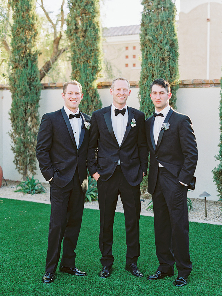 groomsmen in classic black tuxes