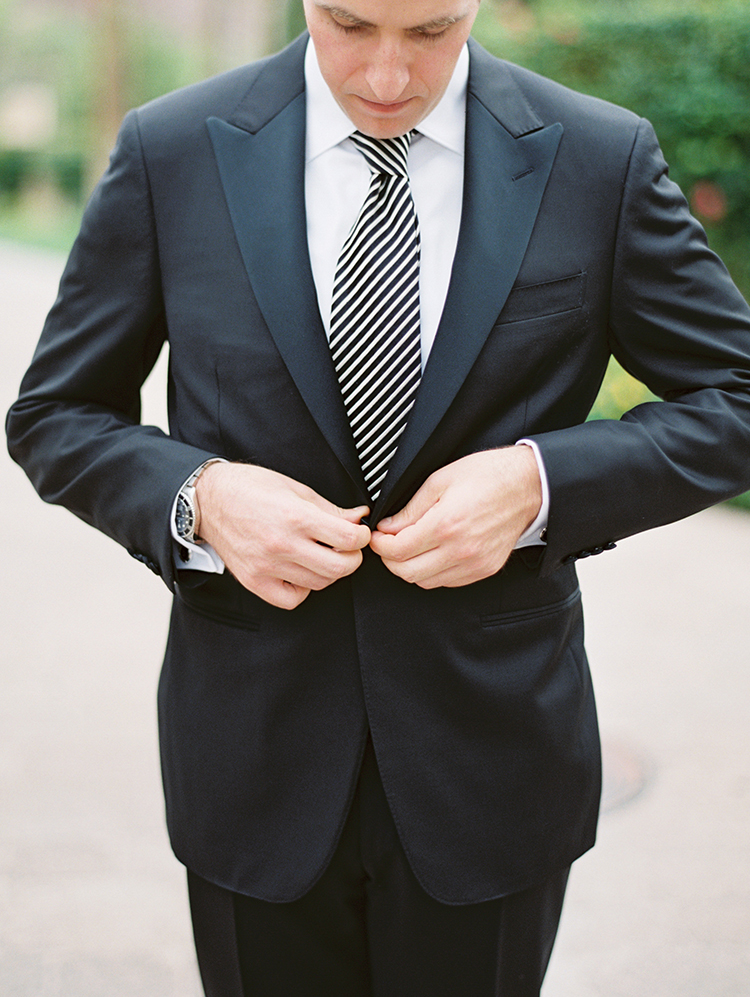 black tux with a striped necktie