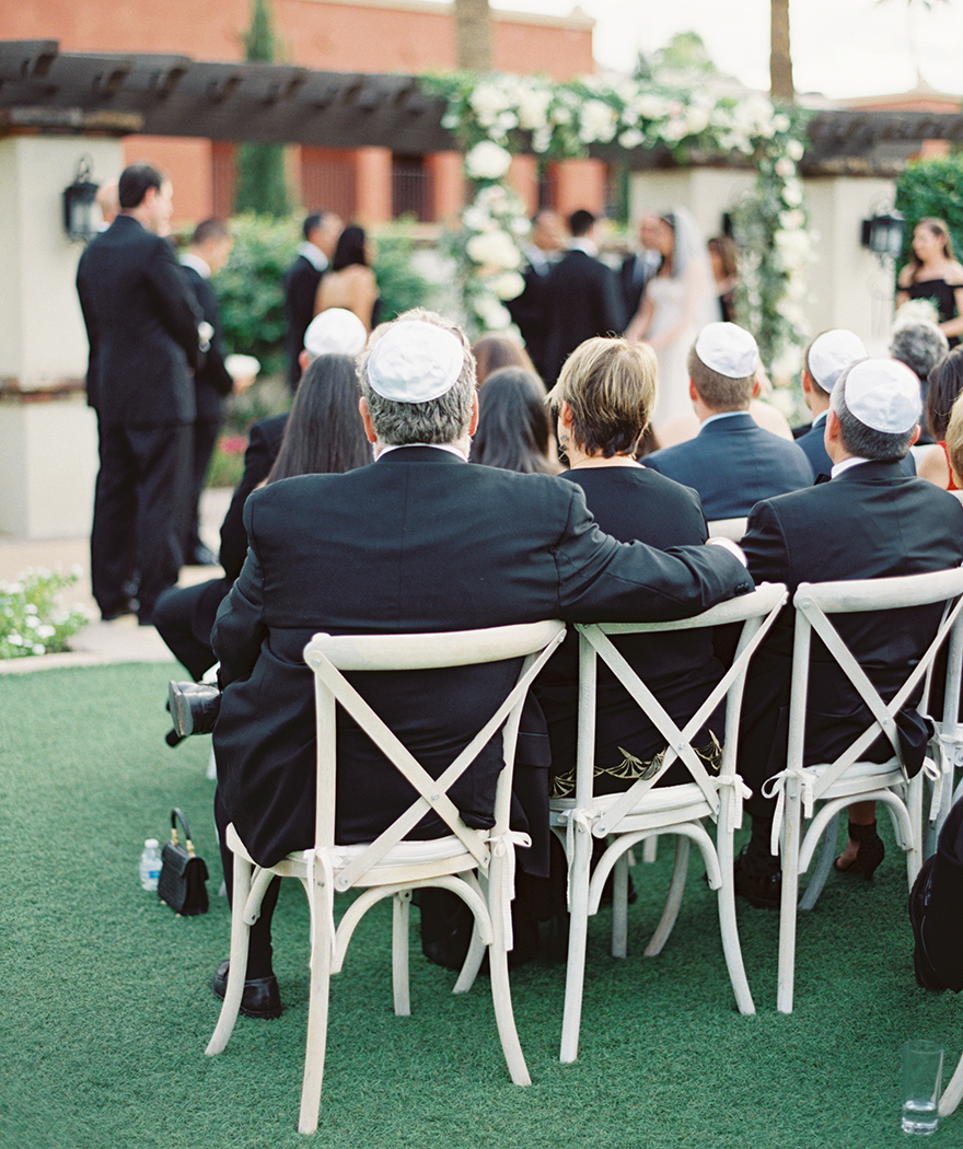 guests in kippot watch an outdoor wedding ceremony at Montelucia