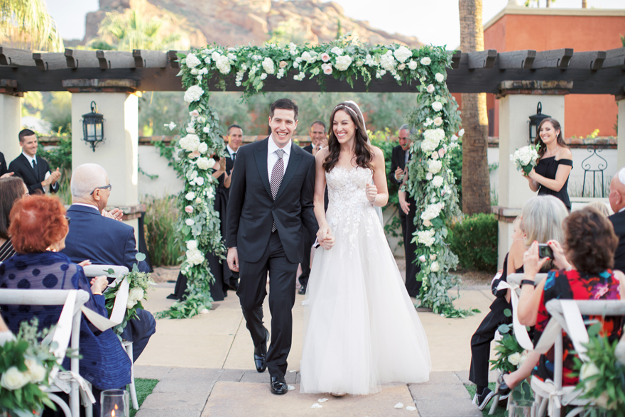 newlyweds share a joyful recessional