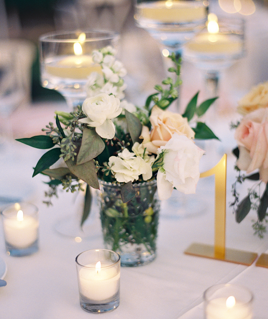 elegant wedding reception with pale flowers & pressed glass