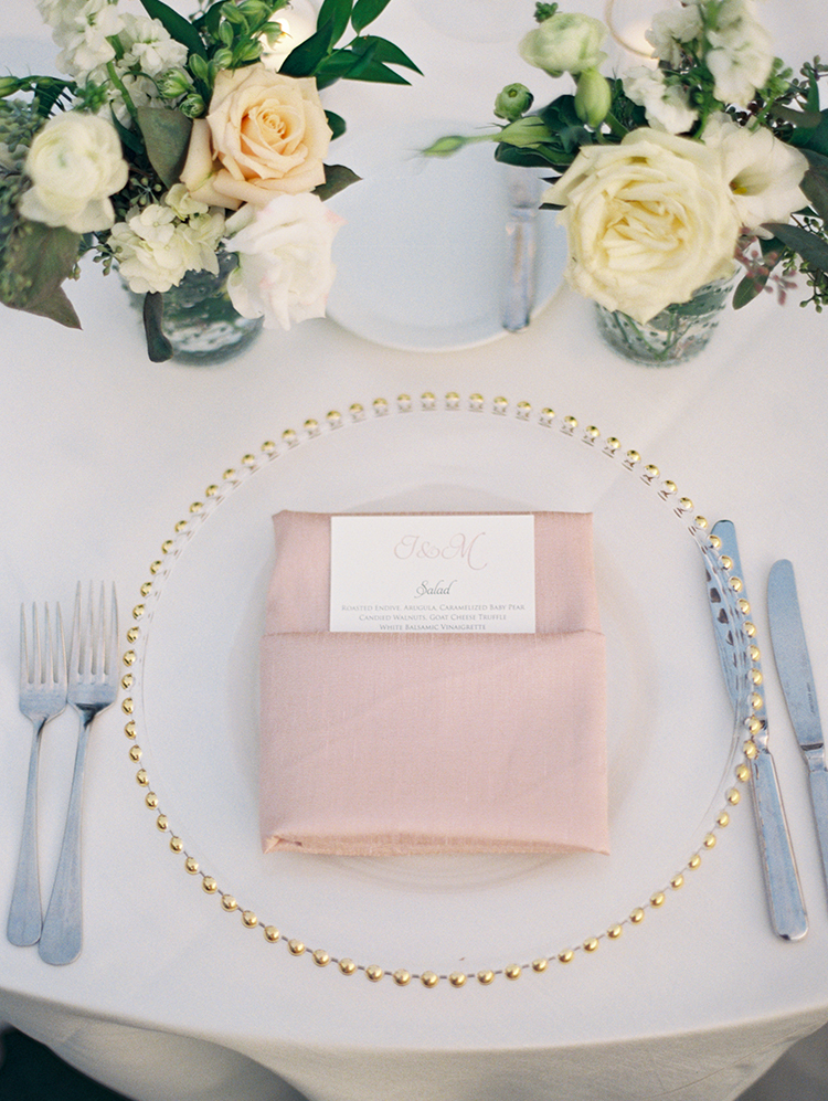 glass charged with gold beaded rim, blush silk napkin
