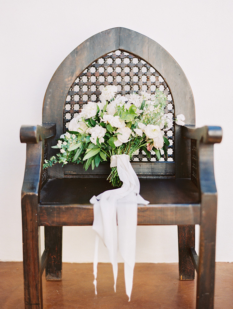 pale, romantic bouquet with soft ribbons