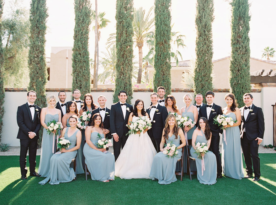 bridesmaids in grey and groomsmen in classic black tuxes