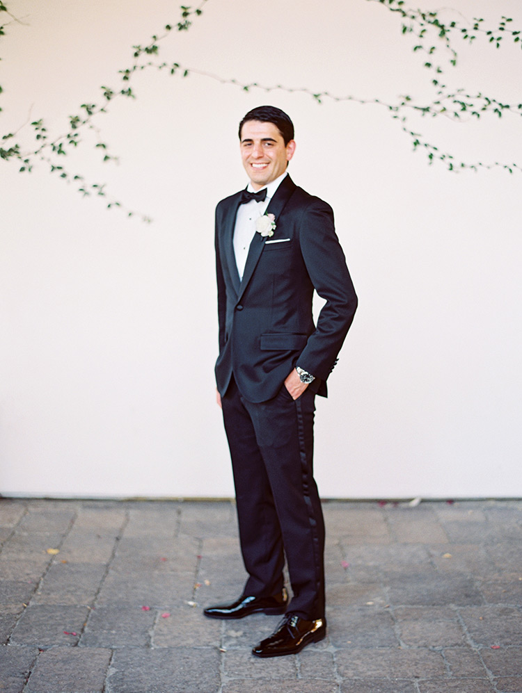 groom in a classic black tux