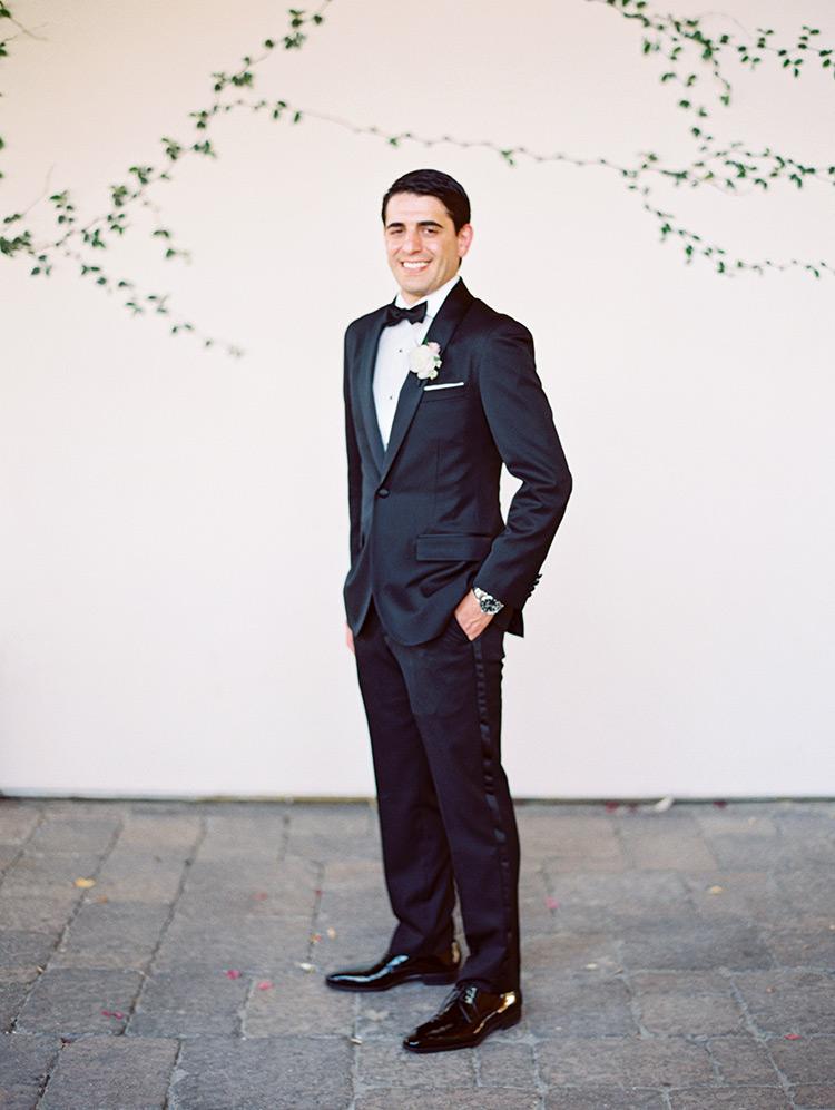 groom in a classic black tux