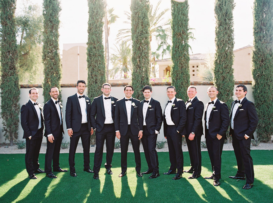 groomsmen in classic black tuxedoes