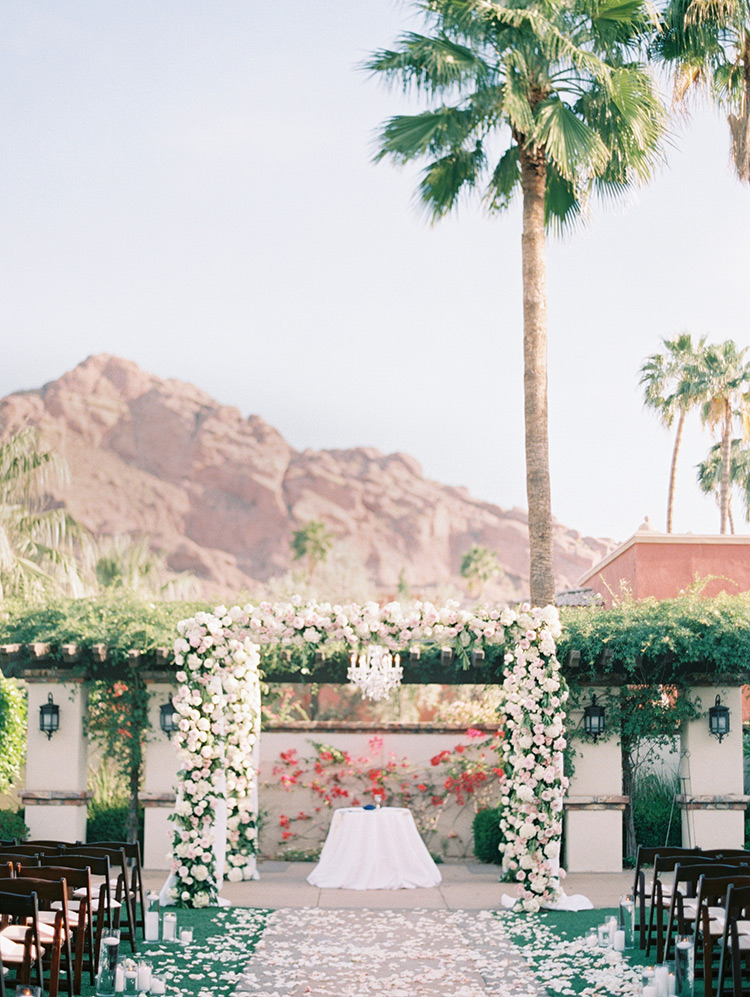 flower-decked chuppah for an outdoor wedding