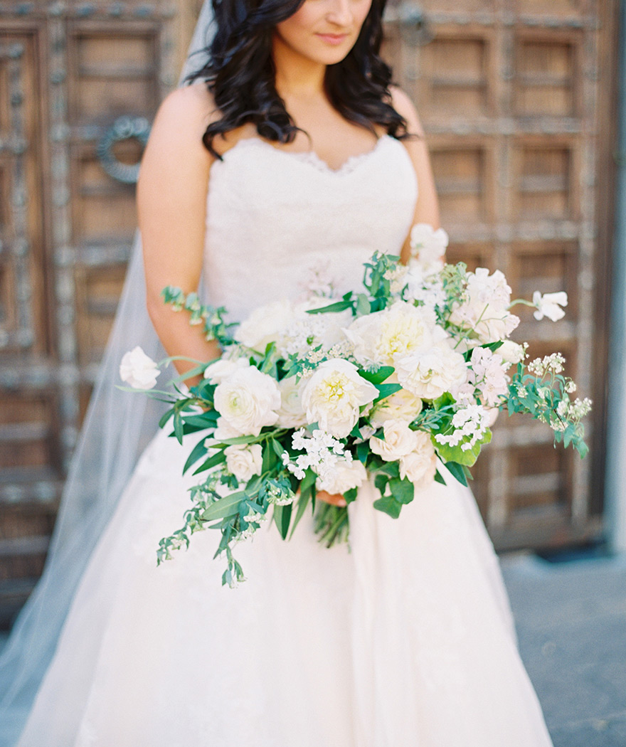 pale, romantic bouquet with trailing ribbons