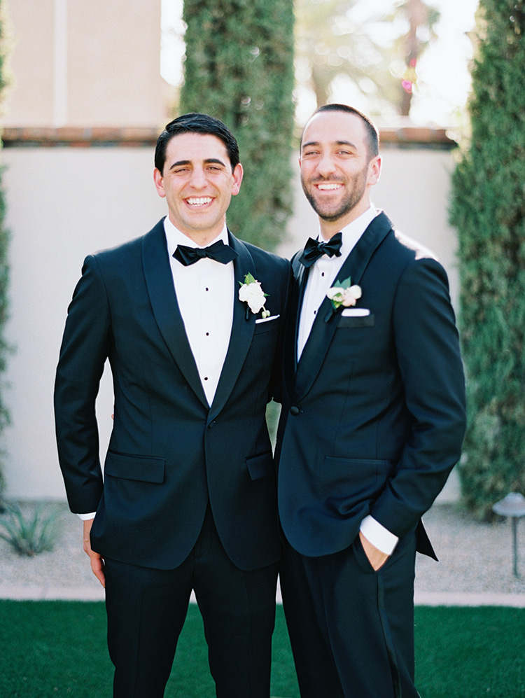 groom & groomsman in black tuxes