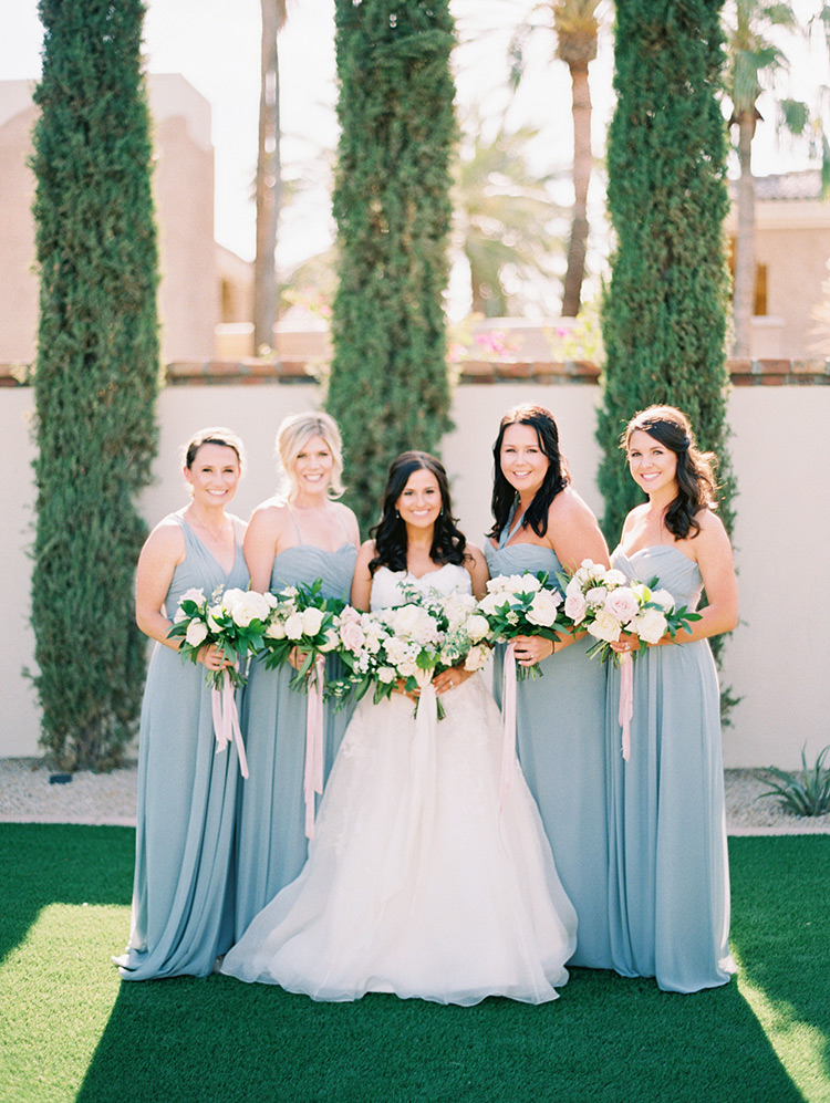 bridesmaids in grey with blush bouquets