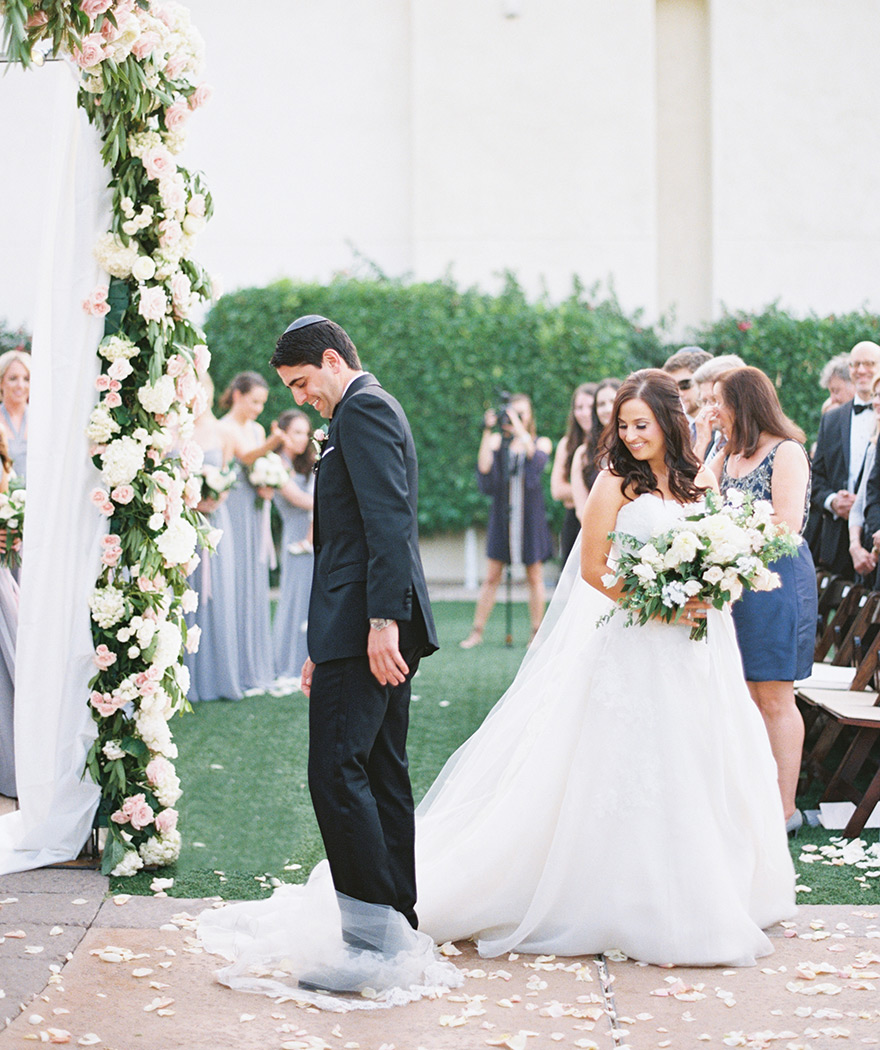 groom circles the bride during an outdoor wedding