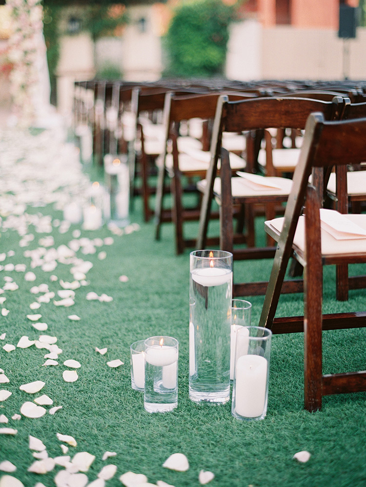 floating candles at an outdoor wedding