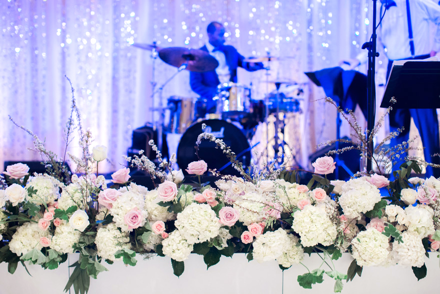 floral stage decorations at a wedding reception