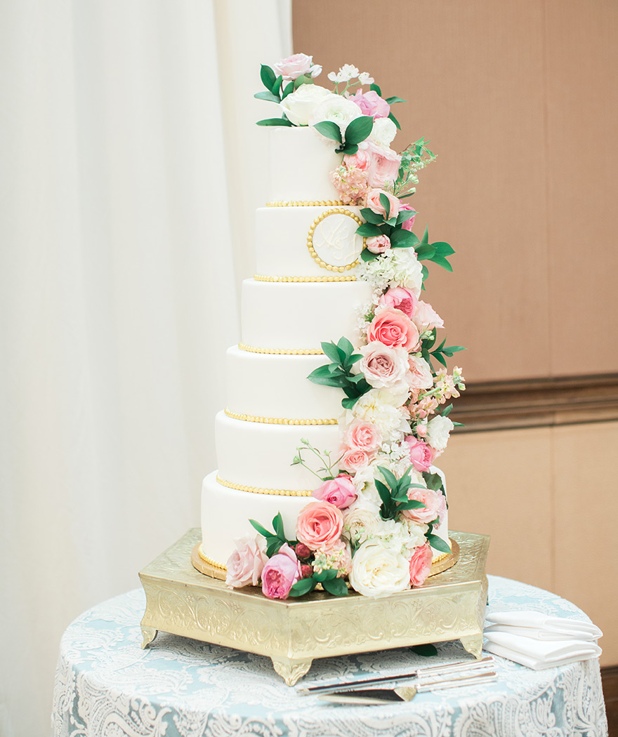 elegant six-tier wedding cake with pink flowers