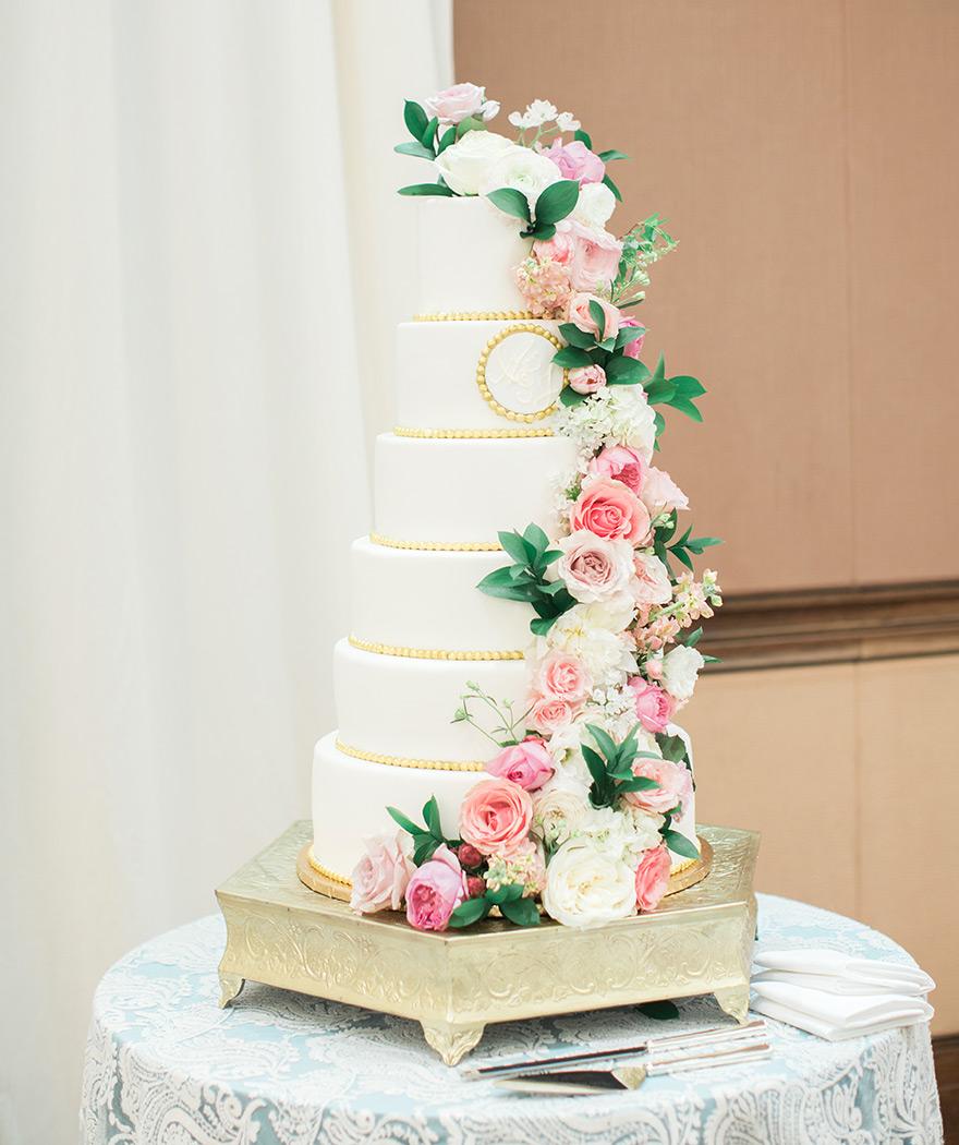 elegant six-tier wedding cake with pink flowers
