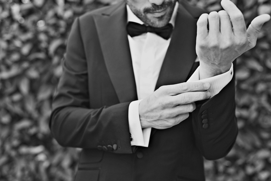 stylish groom in a classic black tux