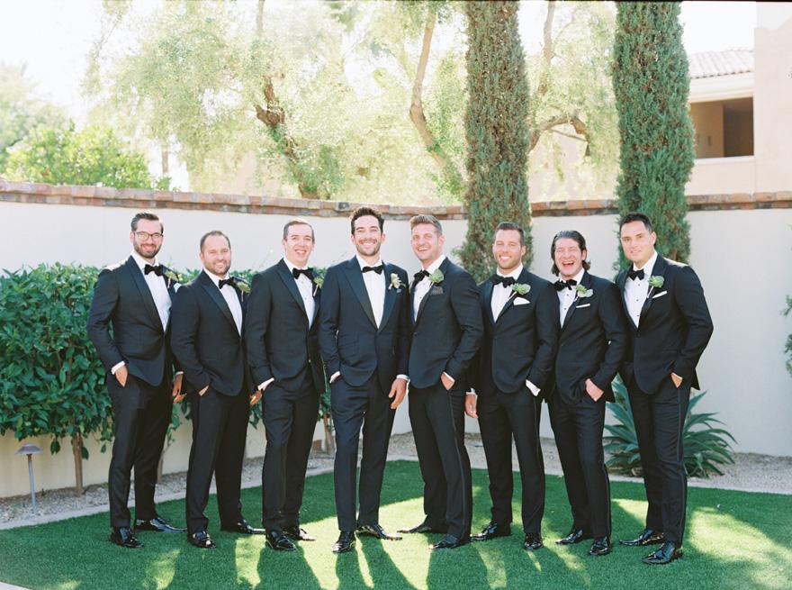 groomsmen in classic black tuxedos