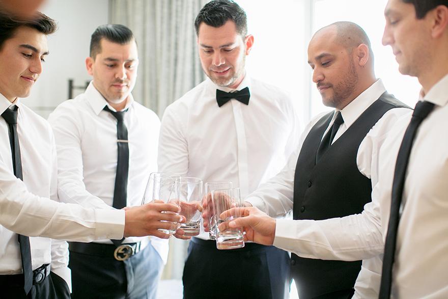 groomsmen celebrate together