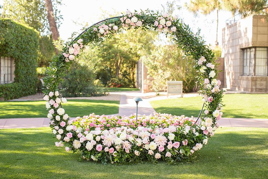 circle flower installation for an outdoor ceremony