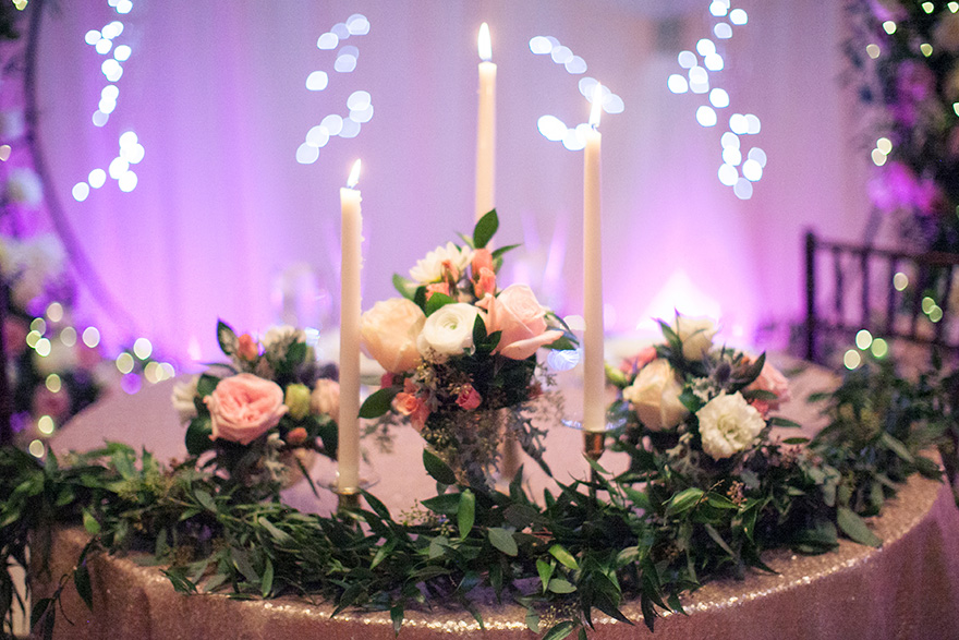 wedding reception with flowers and candlelight