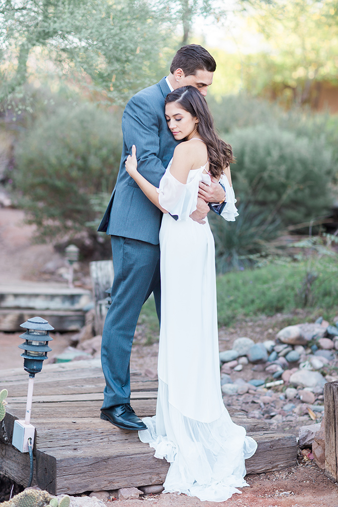 outdoor portraits of an elegant bride & groom