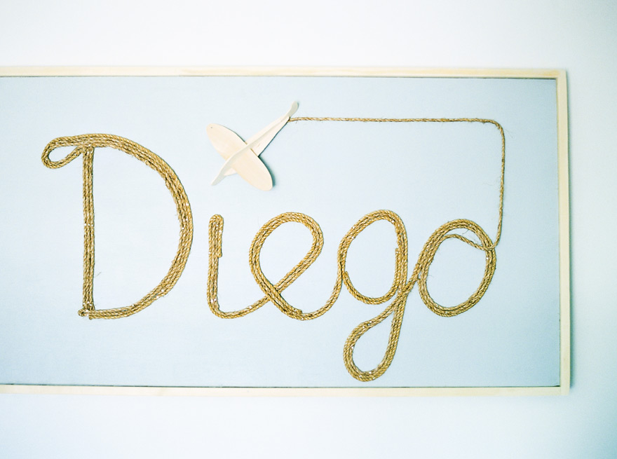 Name sign made out of rope for newborn in a modern nursery
