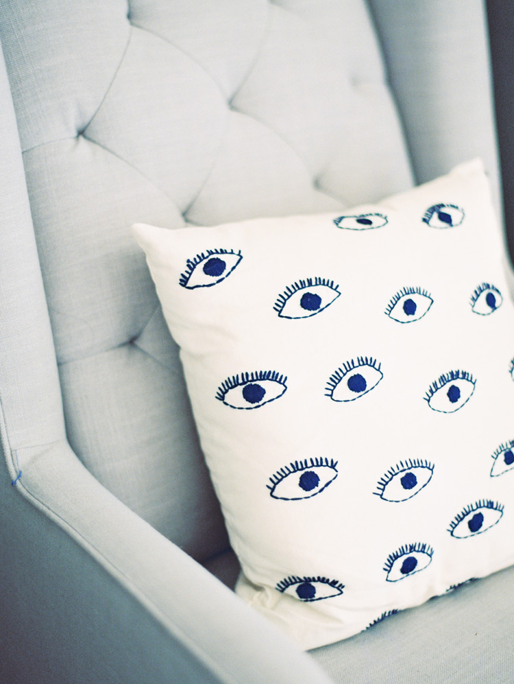eye and eyelash patterned decorative pillow
