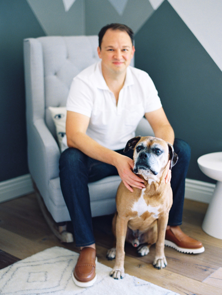 family portraits in a modern nursery with family dogs