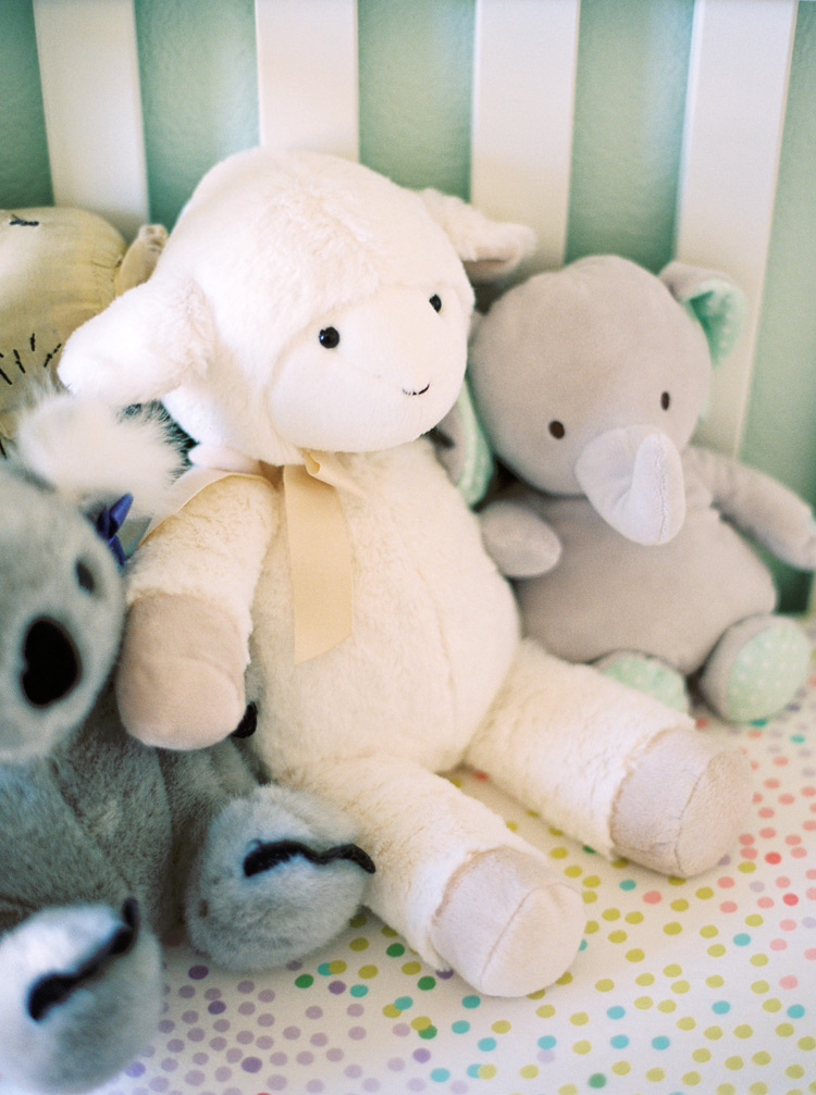Sweet stuffed animals in a polka dot nursery. Baby's first friends.