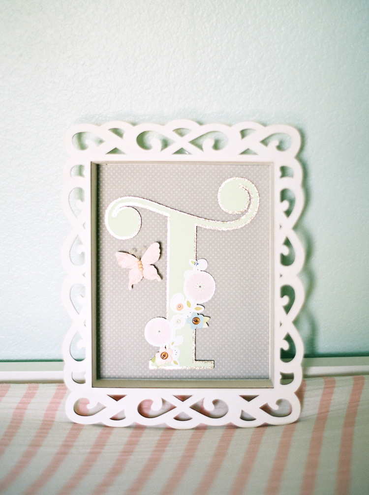 Decorated monogram art in a charming pastel nursery