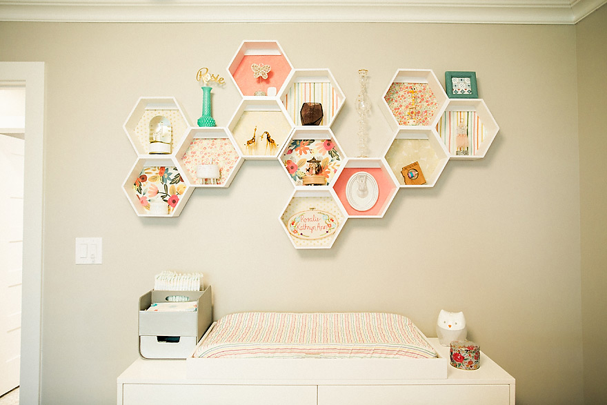 Pastel colored geometric shelves decor on wall.